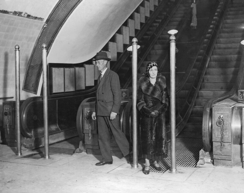 Passengers on an escalator, September 1932. The posts were erected to avoided a crush during rush hours..jpg