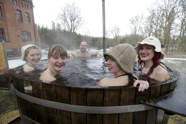 People enjoy a bath in hot kvass, a traditional fermented beverage made from rye bread, during the s
