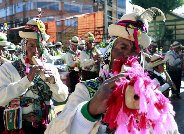 "Indigenous musicians play ""Tarkas"", a native instrument, during the Anata Andina (Andean carnival) p"
