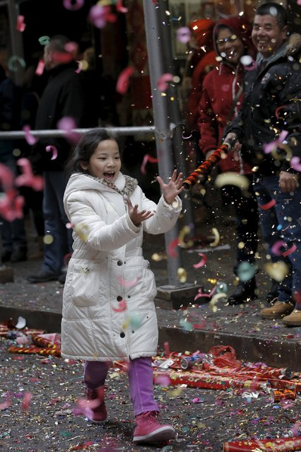 People celebrate the Chinese Lunar New Year in Manhattan's Chinatown in New York February 8, 20