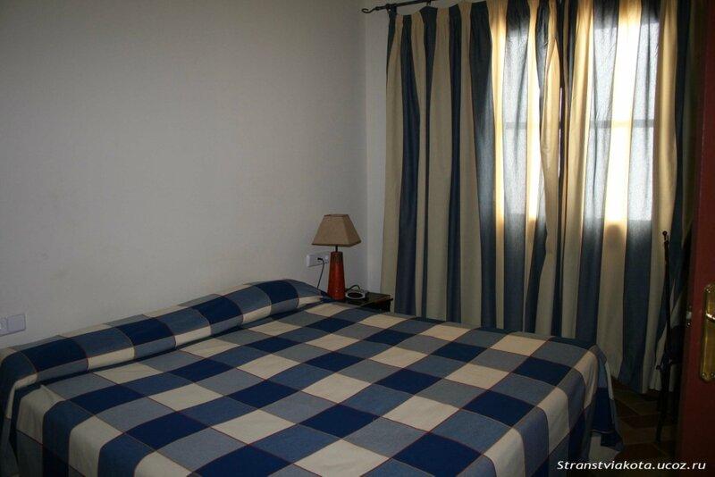 Севилья, Спальня в Suites Santa Cruz