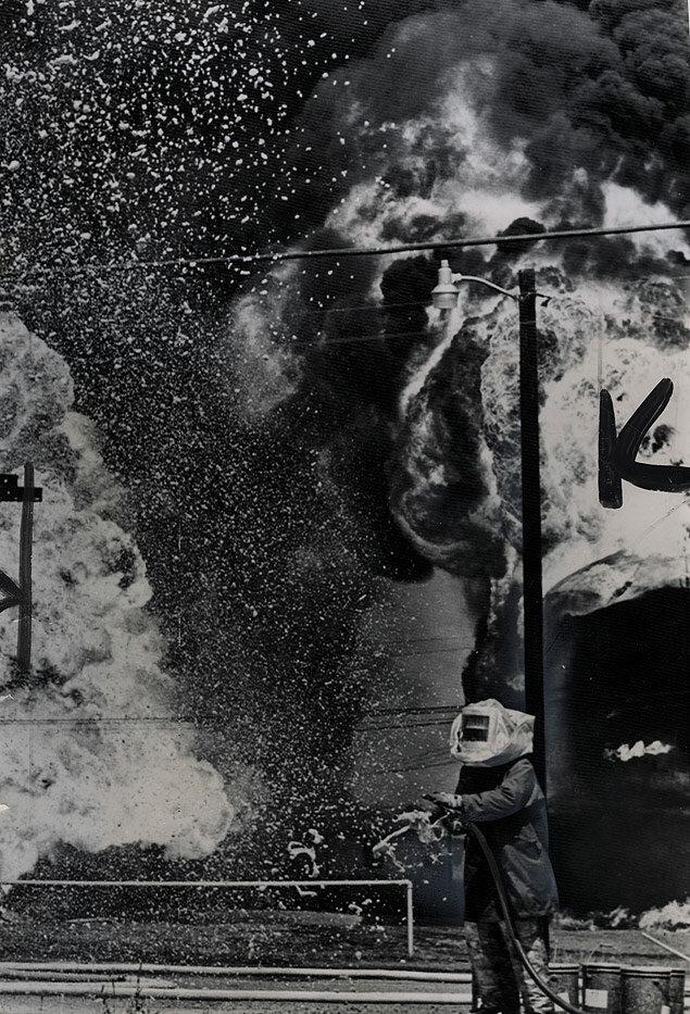 A fireman in an asbestos suit battles a refinery fire at the legendary Burkburnett Oil Fields in Texas
