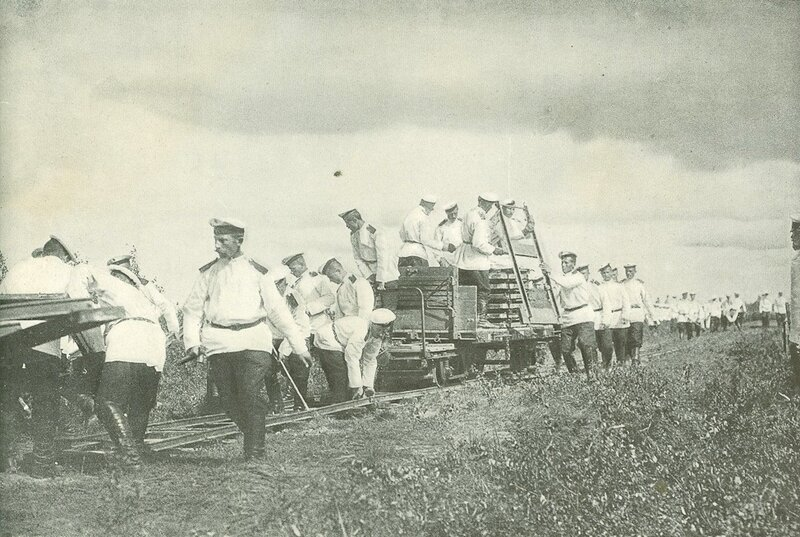 Russian soldiers laying a military railroad on a field during the Russo-Japanese War, 1904.