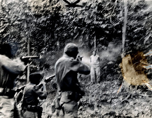 Cuban firing squad executes an alleged bandit chief at the hideout of rebel leader Fidel Castro 1958.jpg