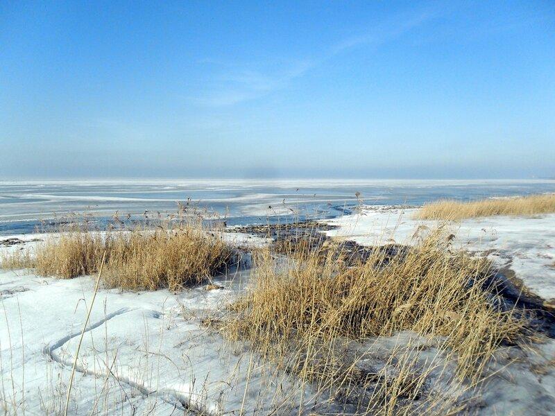 На велосипеде у моря зимнего