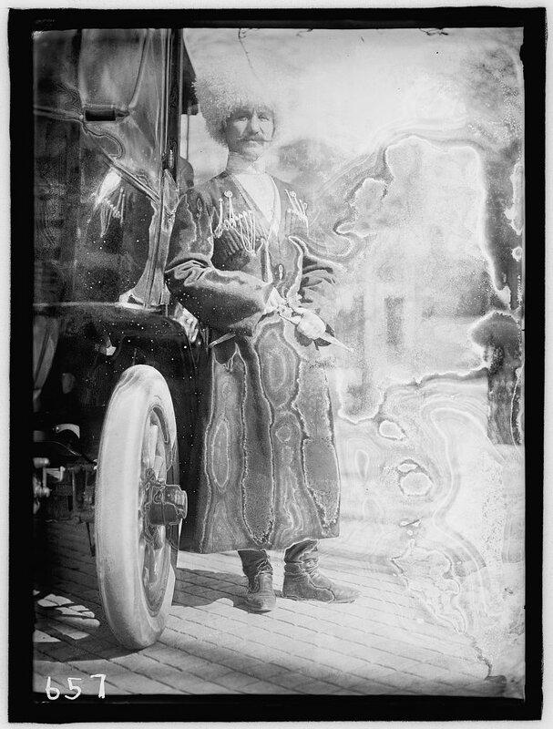 RUSSIAN EMBASSY. COSSACK FOOTMAN, OF EMBASSY STAFF 1911.