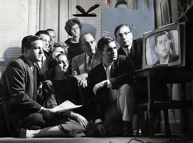 Members of a Cuban exile group listen as President Kennedy addresses the nation on television to announce his forthcoming blockade to halt the construction of Soviet missiles in Cuba