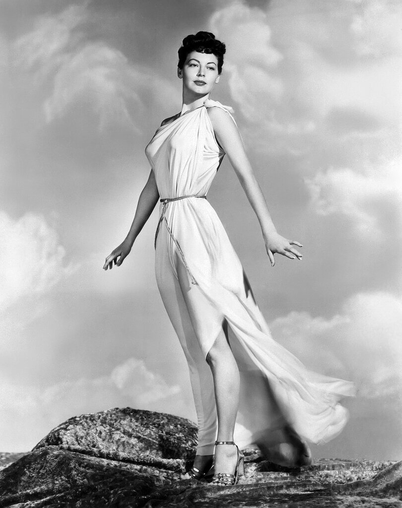 7/20/1948- Hollywood, CA- The breeze toys with the classic Grecian costume of a modern Venus as she stands high on a Hollywood hilltop. Luscious Ava Gardner, who stars in the forthcoming