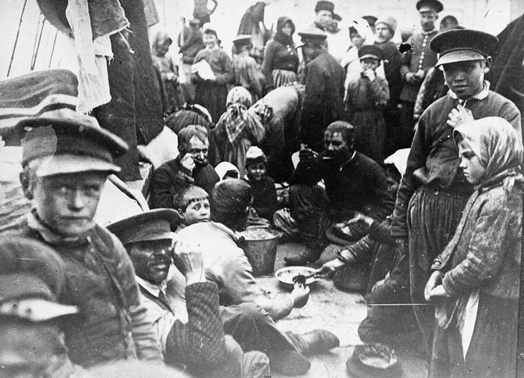 Doukhobors at mealtime aboard the SS Lake Huron, on the way to Halifax, January 1899