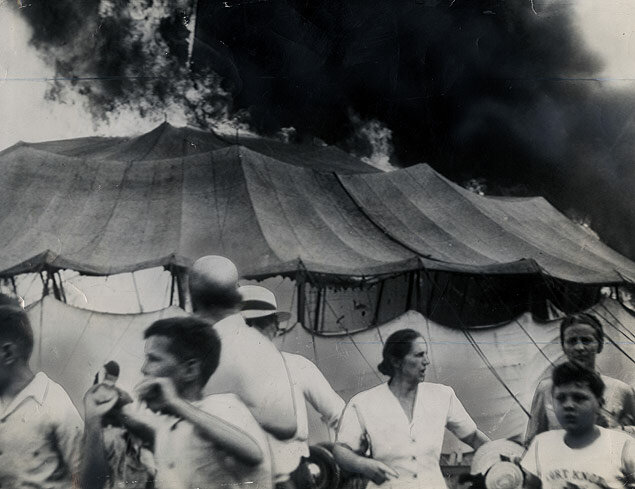 Visitors flee the catastrophic fire consuming the big top of the Ringling Brothers Barnum & Bailey Circus in Hartford, Connecticut