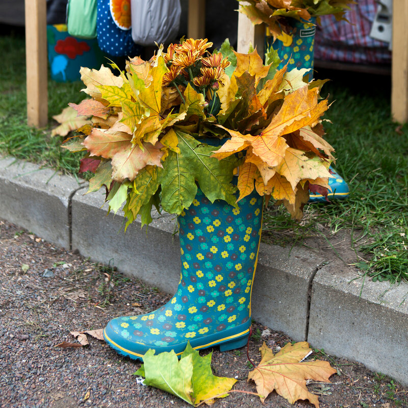 Autumn boot with maple, steet decoration