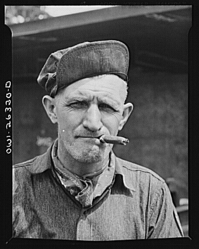 Bethlehem-Fairfield shipyards, Baltimore, Maryland. Trainman with a cigar1943.