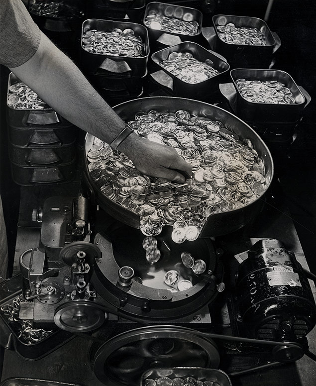 Employed at the U.S. Mint in Philadelphia, an automatic money counter uses centrifugal force to separate and count newly-minted nickels