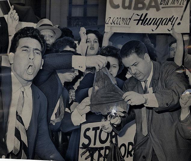 Anti-Castro demonstrators burn the Soviet flag outside of the Russia's UN delegation headquarters 1961
