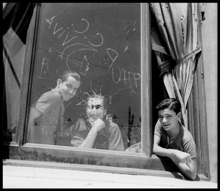 Gerda Taro - Three men in the window of the Hotel Colón, headquarters of the PSUC (United Socialist Party of Catalonia), Barcelona, August 1936