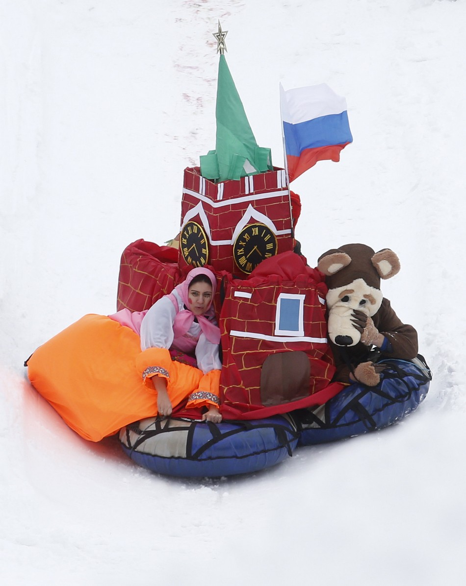 "Participants compete during a contest on the longest distance and the most creative performance at the ""Battle sani"" festival of self-made sledges in Moscow"