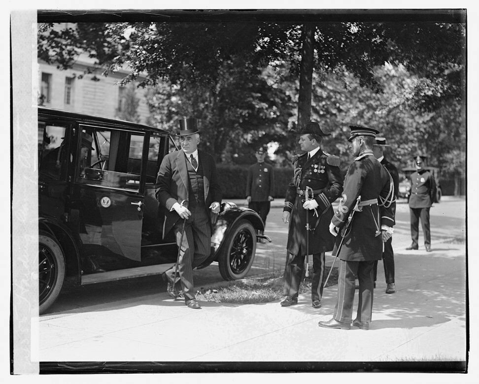 1923 President Harding is greeted by his military aides as he leaves the Pierce Arrow limousine.jpg