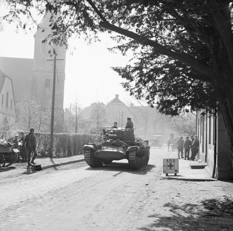 A Valentine Mk XI artillery OP tank passing through Hopsten, 6 - 8 April 1945.