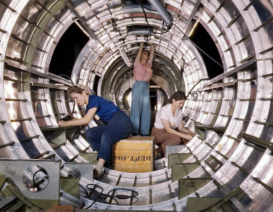 October 1942. Workers installing fixtures and assemblies in the tail section of a B-17F bomber at the Douglas Aircraft Company plant in Long Beach, California.jpg