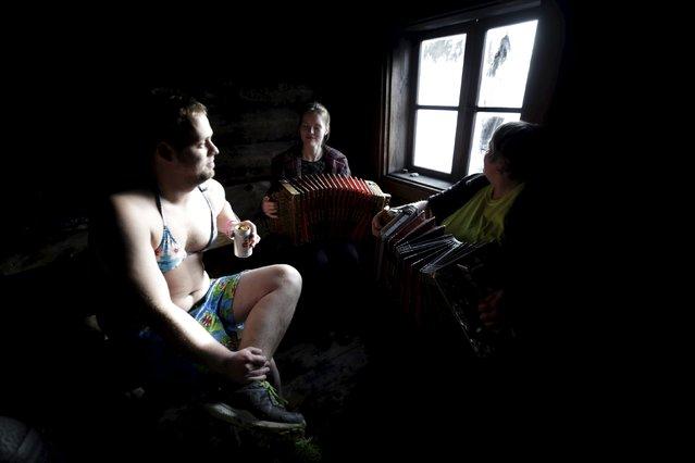 A man rests as he listens to local musicians during the sauna marathon near Otepaa, Estonia, Februar