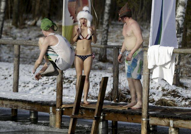 A man jumps into a cold water pool during the sauna marathon near Otepaa, Estonia, February 6, 2016.