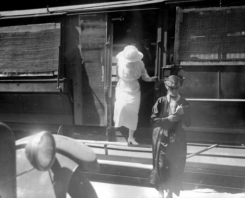 Women exit a Denver Tramway Company trolley that has screened windows and doors, probably during the Denver Tramway strike, Denver, Colorado, 1920