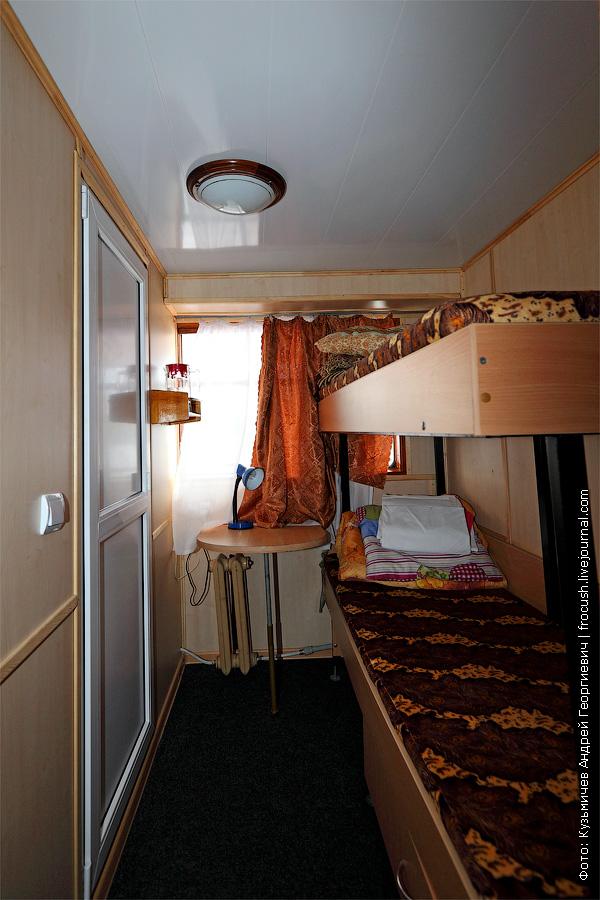 Двухместная двухъярусная каюта №5 на средней палубе. теплоход Белинский фото интерьеров