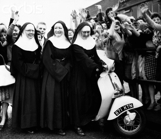 Factory Workers Present Scooter to Nuns