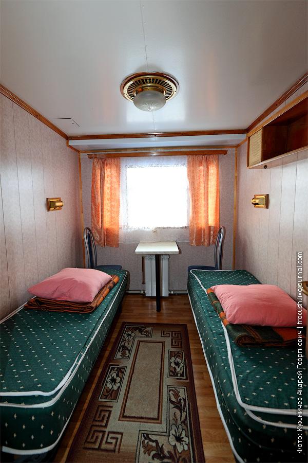 Двухместная одноярусная каюта №60 на средней палубе с умывальником. теплоход Г.В.Плеханов