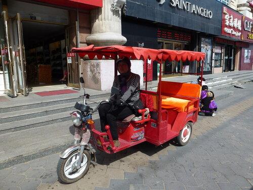моторикша в китайском Хэйхэ