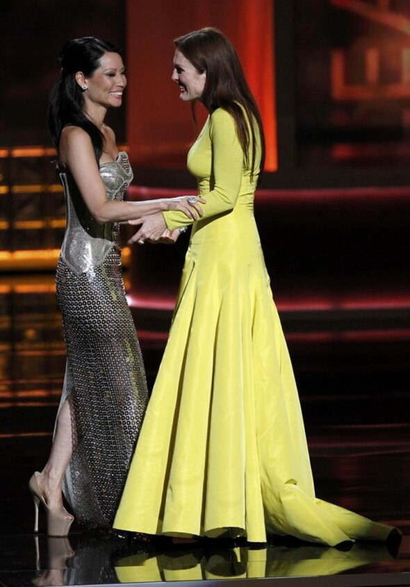 Moore is greeted by presenter Liu after winning the award for outstanding lead actress in a miniseries or movie at the 64th Primetime Emmy Awards in Los Angeles