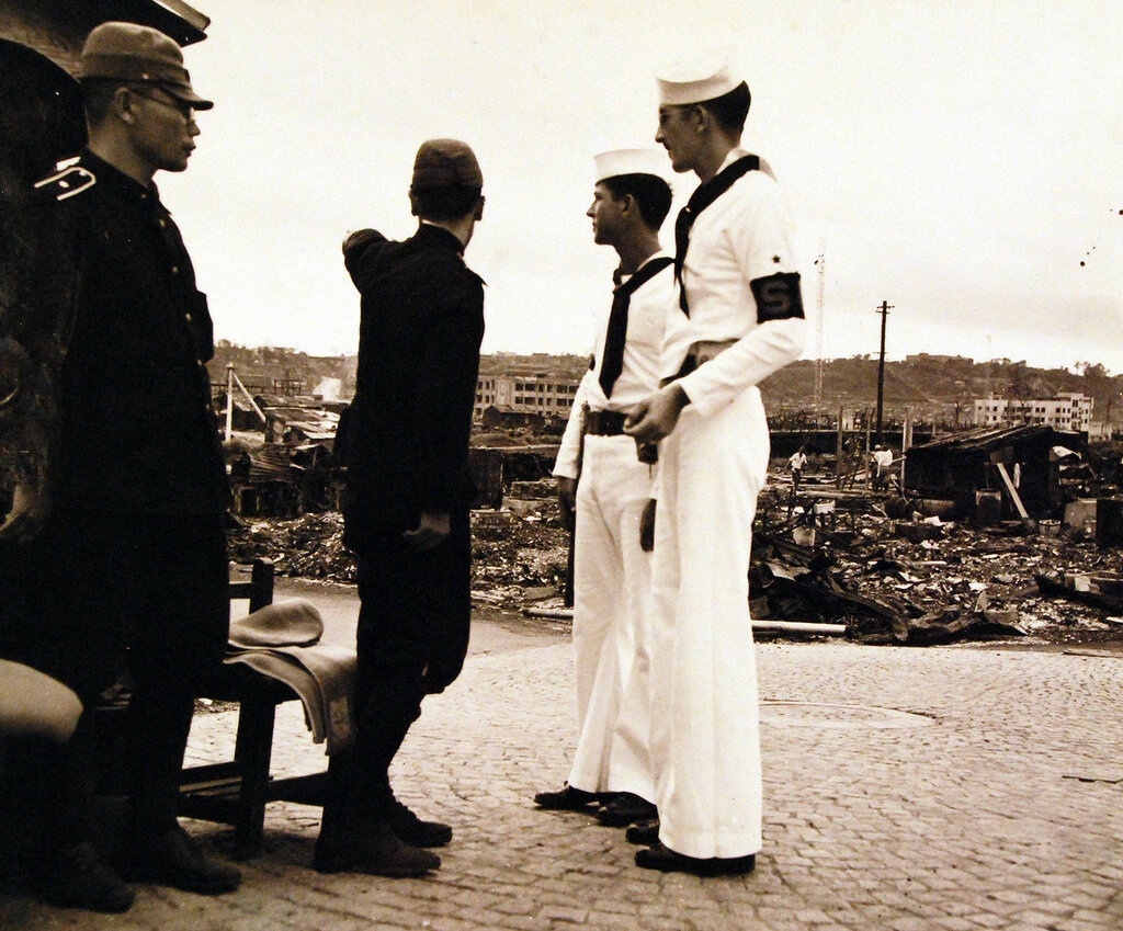 Japanese policeman cooperate with Shore Patrol.