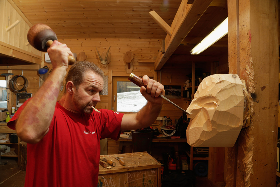 Woodcarver Richard Kranawetvogl starts to carve a Krampus mask in his workshop in Marktschellenberg,