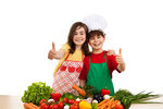Healthy eating - kids and fresh vegetables isolated on white
