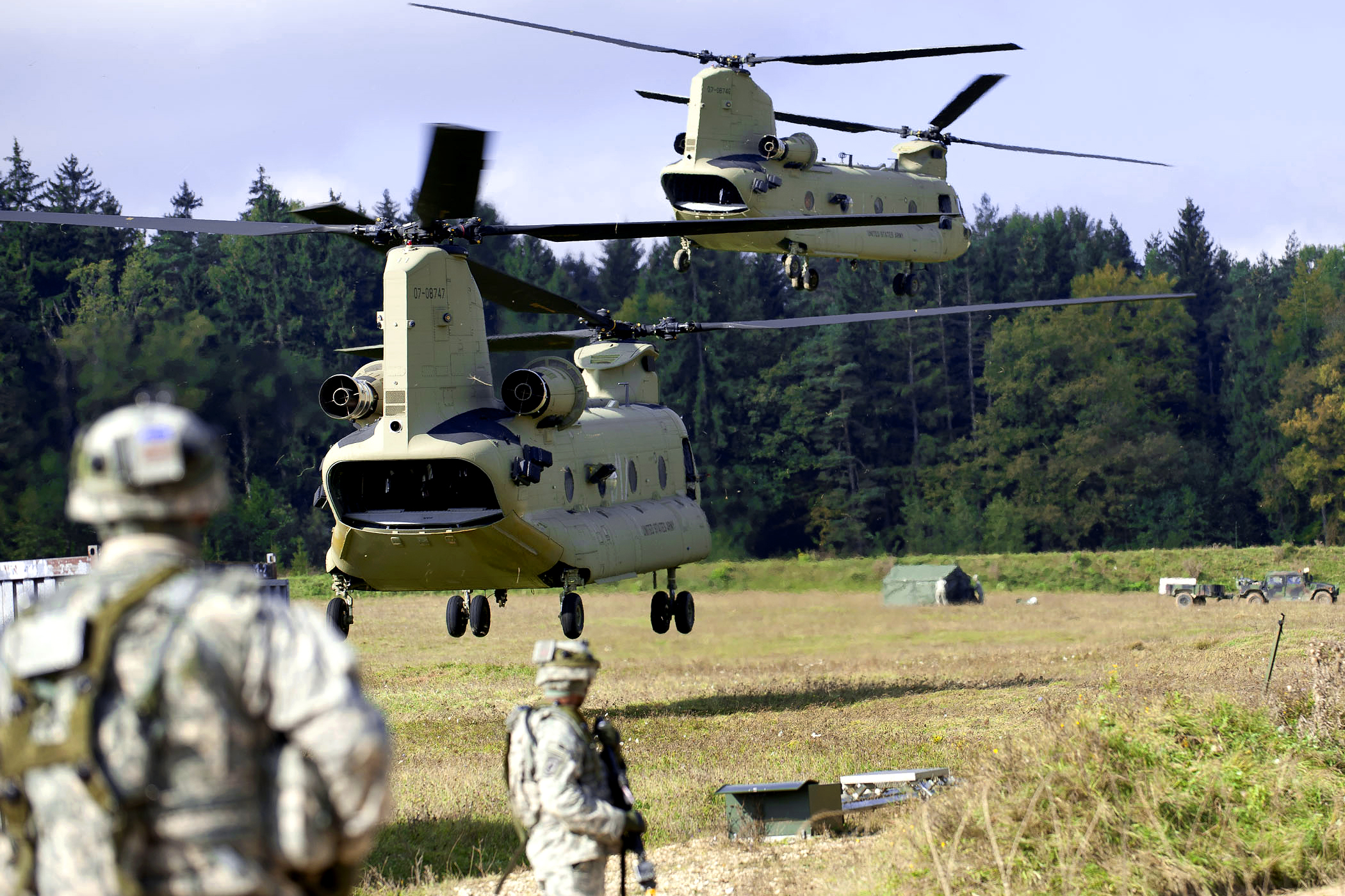 Two Chinooks and four Blackhawks, along with two Apache gunships to provide air support, all from the 12th Combat Aviation Brigade, support soldiers assigned to the 173rd Airborne Brigade Combat Team that are going to air assault into an objective as part