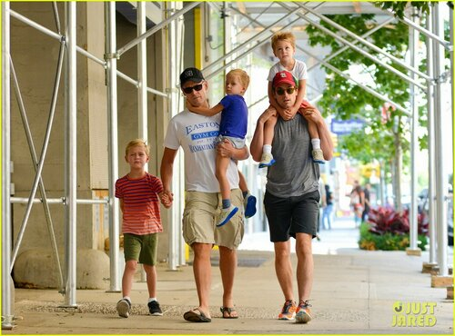 """White Collar"" star Matt Bomer is spotted out for a stroll with his partner Simon Halls and their kids Henry, Walker, and Kit in New York City"