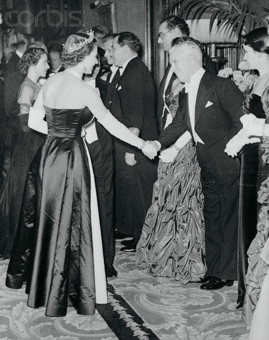 Queen Elizabeth Shaking Hands with Charlie Chaplin