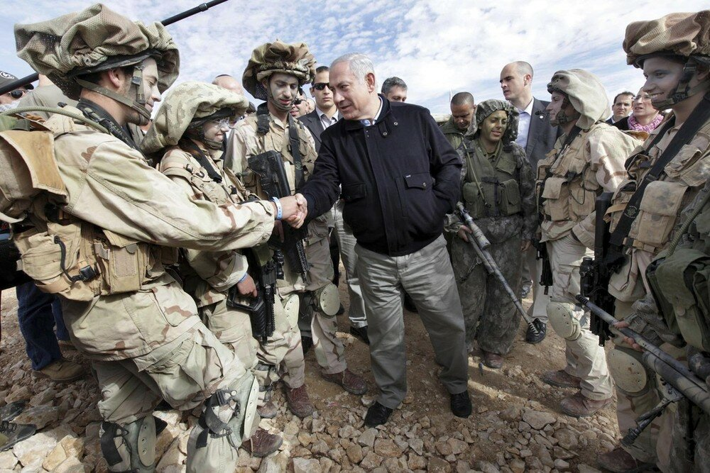 Israel's PM Netanyahu meets with soldiers from the IDF during a tour of the Israel and Egypt border in southern Israel