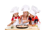 Kids and their mother preparing a pizza