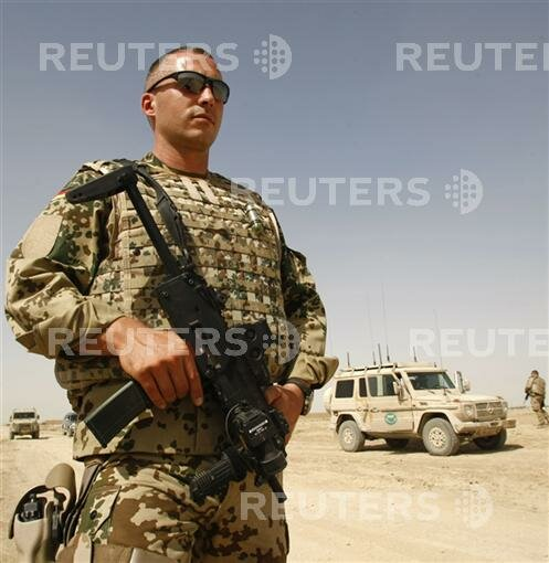 A German Bundeswehr army soldier of ISAF forces monitors area during a mission in Masar-i-Sharif