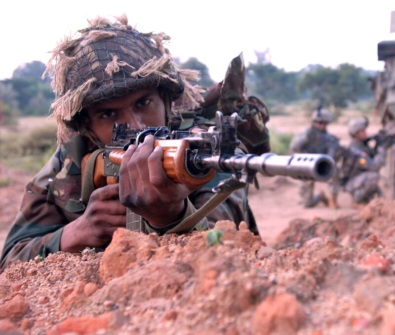 "CAMP BUNDELA, India (Oct. 25, 2009)  –– An Indian army Soldier prepares to advance towards a village with U.S. Soldiers from Troop A,  2nd Squadron, 14th Cavalry Regiment ""Strykehorse,"" 2nd Stryker Brigade Combat Team, 25th Infantry Division, from Schofie"
