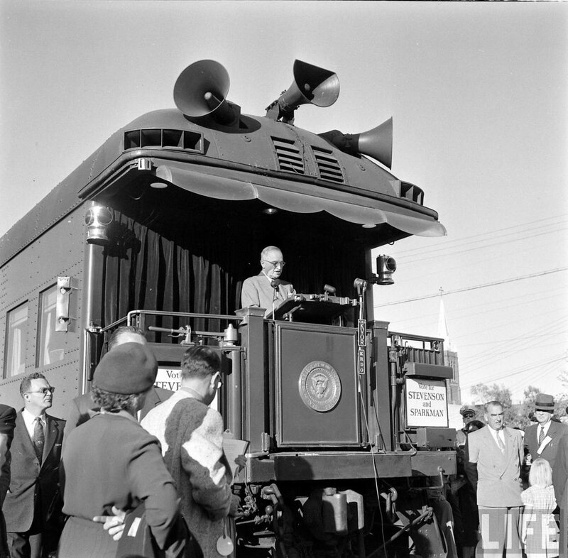 Truman addresses a crowd from the back of a train during his whistle-stop tour,.jpg
