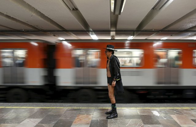 "A passenger not wearing pants waits for a subway train during the ""No Pants Subway Ride"" in Mexico C"
