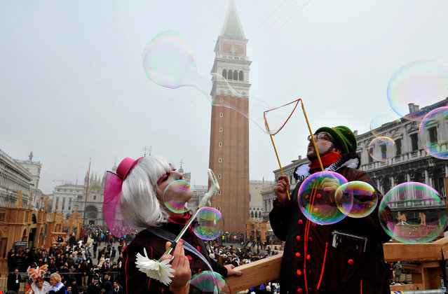 Artists blow bubbles in St. Mark's Square in Venice, Italy, Sunday, January 31, 2016. Carnival-