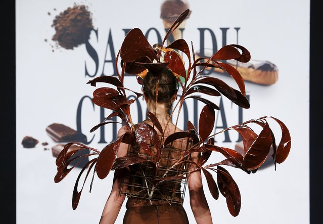 "A model dressed in an outfit made with chocolate presents a creation at the Brussels ""Le Salon du Ch"
