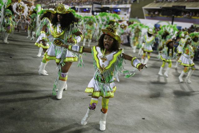 Revellers of the Imperatriz samba school perform during the carnival parade at the Sambadrome in Rio