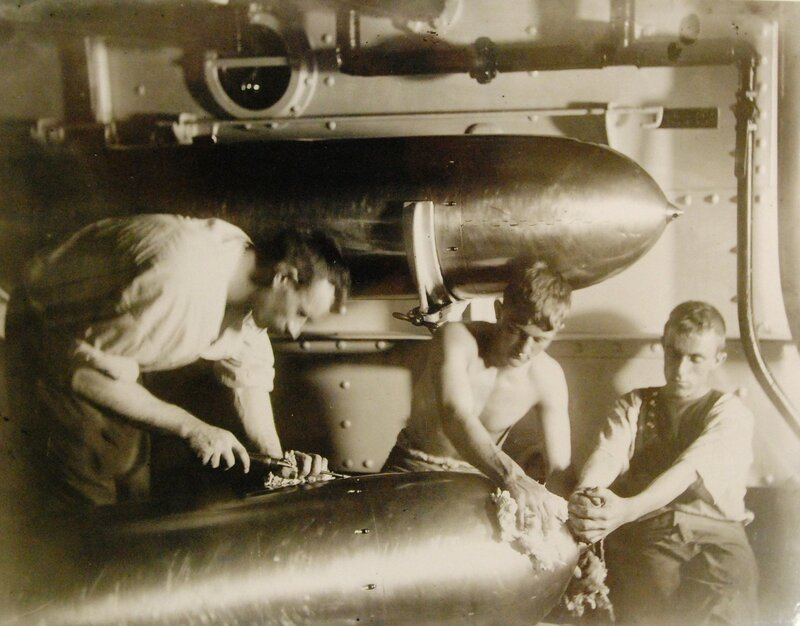 USS Olympia (Cruiser #6), sailors working on torpedo, circa 1899