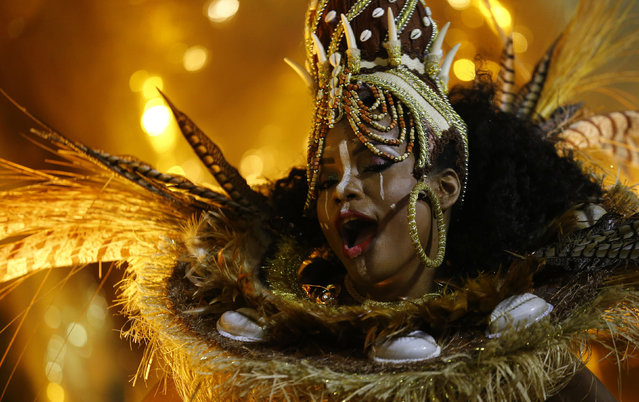A reveller of the Mangueira samba school performs during the carnival parade at the Sambadrome in Ri
