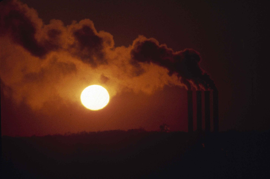 Smog from smokestacks at a power plant darken the sunset in Washington, D.C., in 1983.