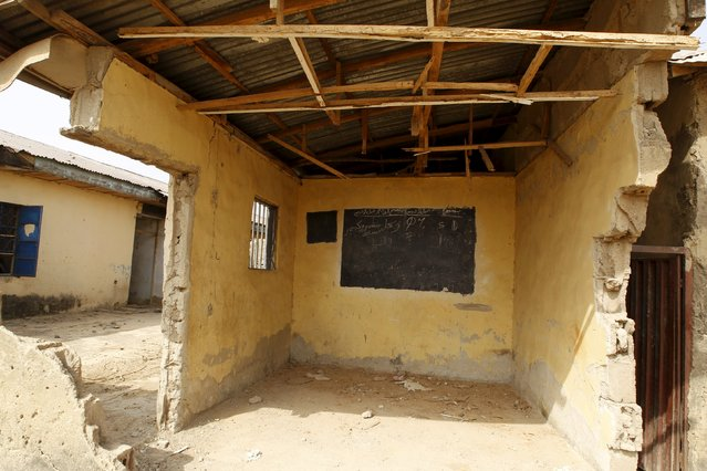 A partly demolished Islamic school block is seen in Gyallesu district after recent clashes between S
